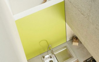cool concrete interior living area kitchen 338x212
