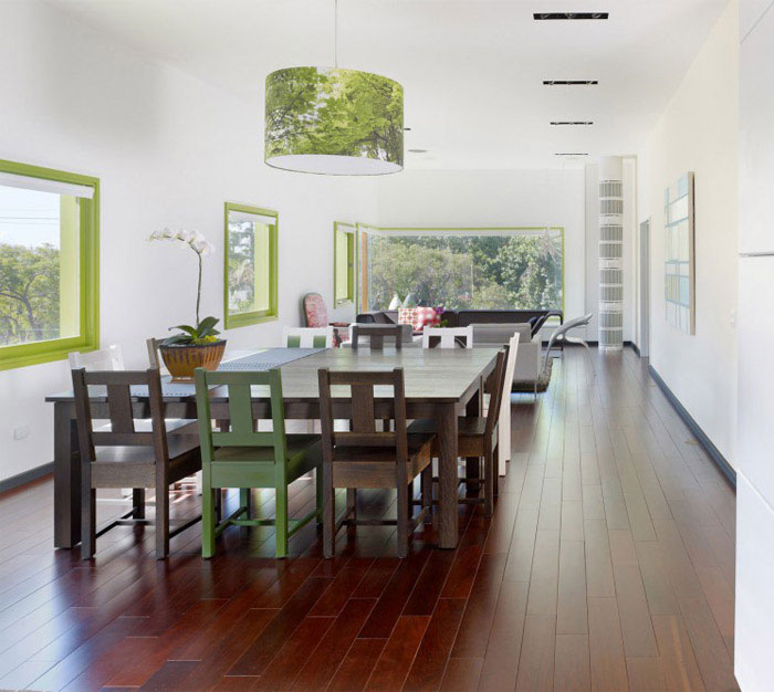 contemporary home with green windows dining area