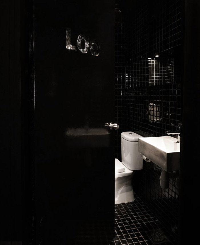 building shophouse black bathroom