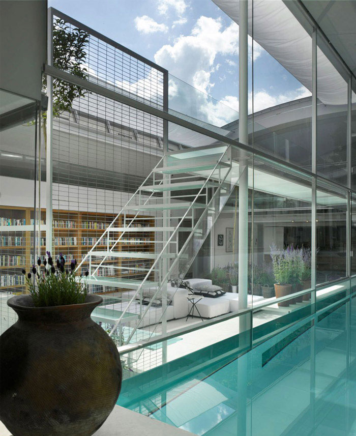 residence with indoor glass pool