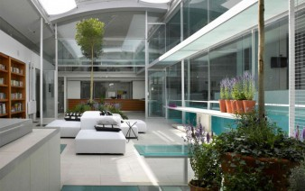 spectacular residence with indoor glass pool living room 338x212