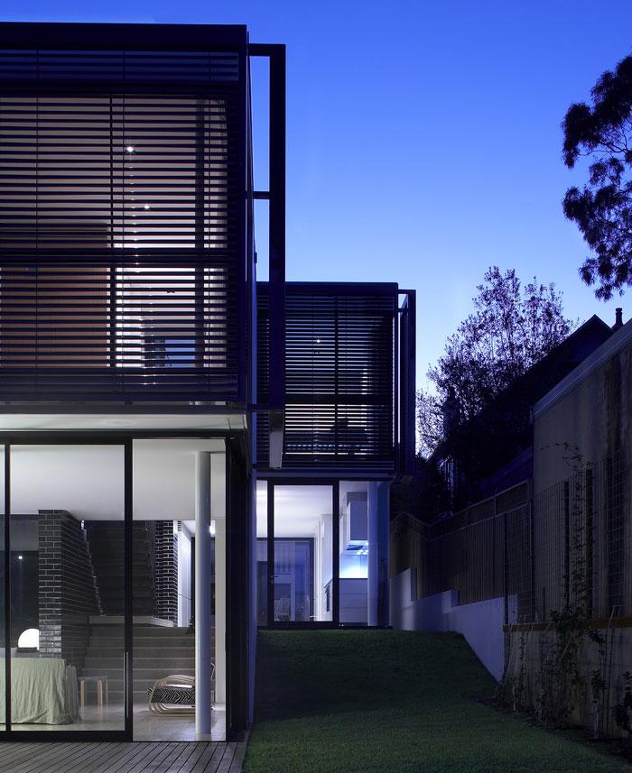 house-constructed-concrete-glazed-black-brickwork-steel