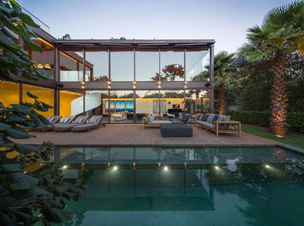 two storey house tropical garden