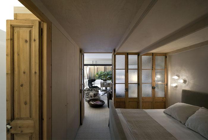 renovated space wooden doors bedroom