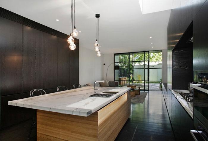 dark timber calcutta marble kitchen decor