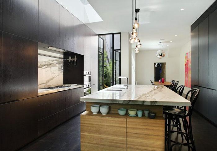 dark timber calcutta marble kitchen interior