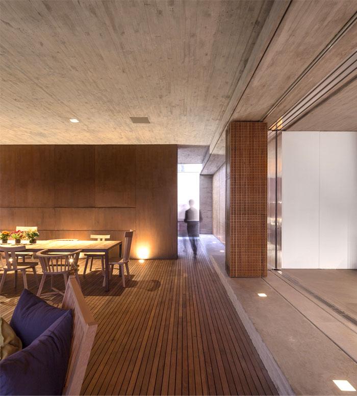 concrete-wall–fireplace-sliding-bamboo-walls