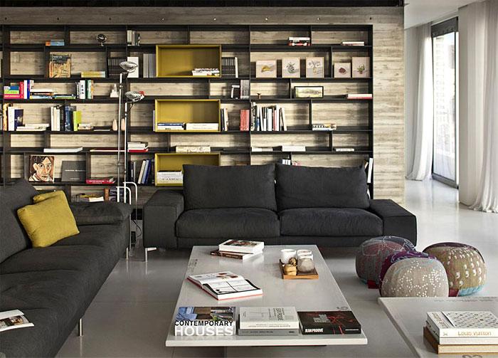 tel-aviv-penthouse-dark-metal-bookcase-raw-concrete-wall