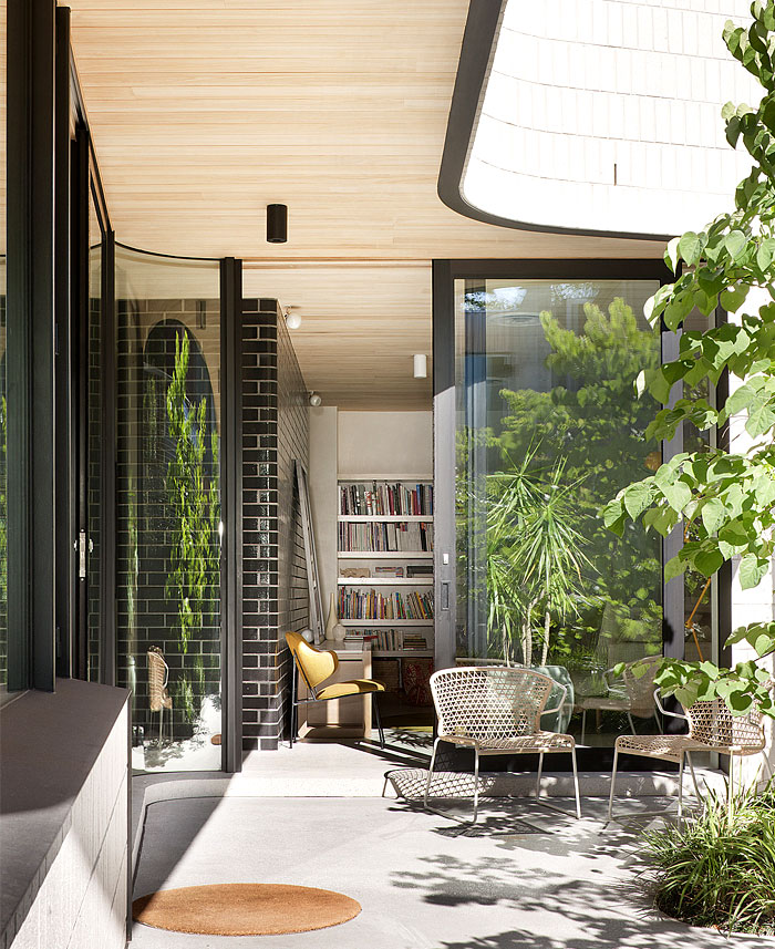 concrete-floor-continues-outdoor-courtyard