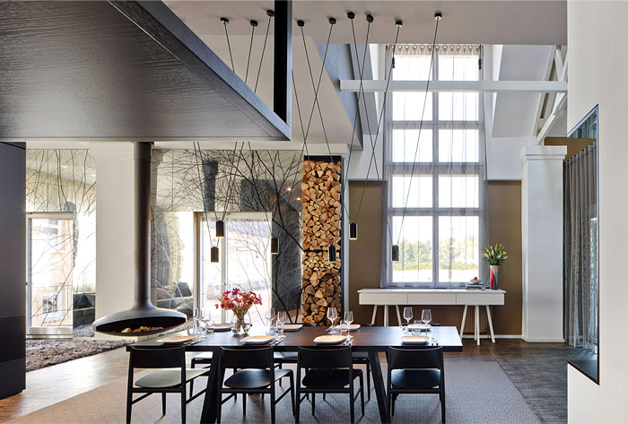 open-spacious-living-space-sculptural-suspended-wood-burning-stove