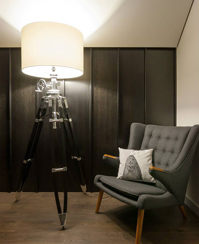 techno-lamp-and-gray-armchair