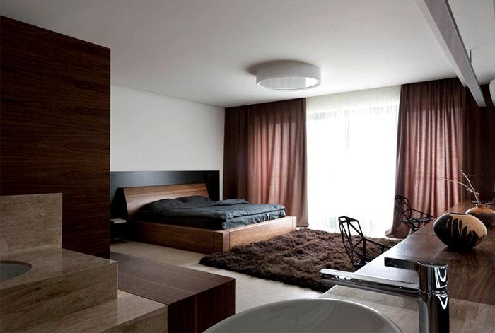 dark-draperies-soft-rugs-bedroom