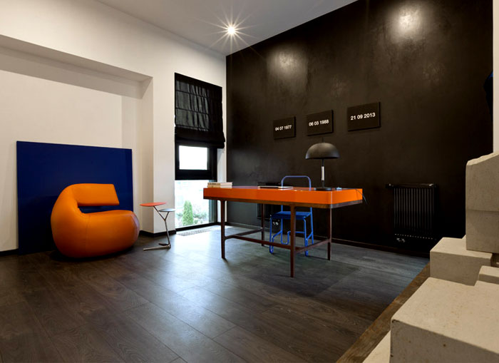 office-matte-black-walls-vibrant-orange-blue-furniture