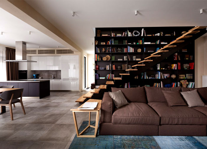 two-story-high-bookshelf-pale-wooden-staircase