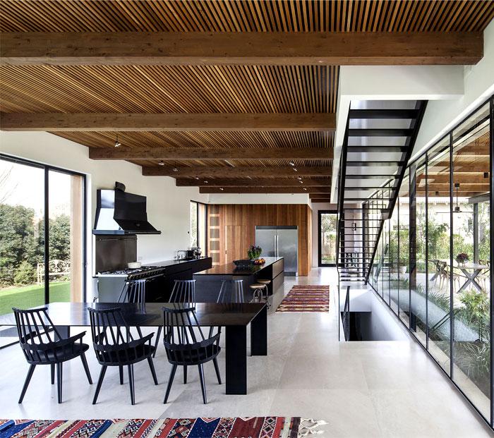 black-steel-cedar-panels-gray-concrete-interior-2