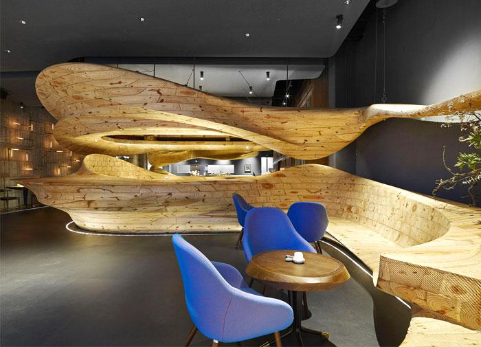 organically sculptured wooden decor raw restaurant