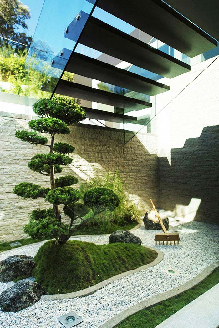 contemporary small zen garden under sairs