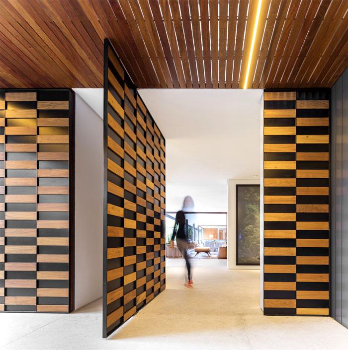 l shaped house jacobsen arquitetura studio 11