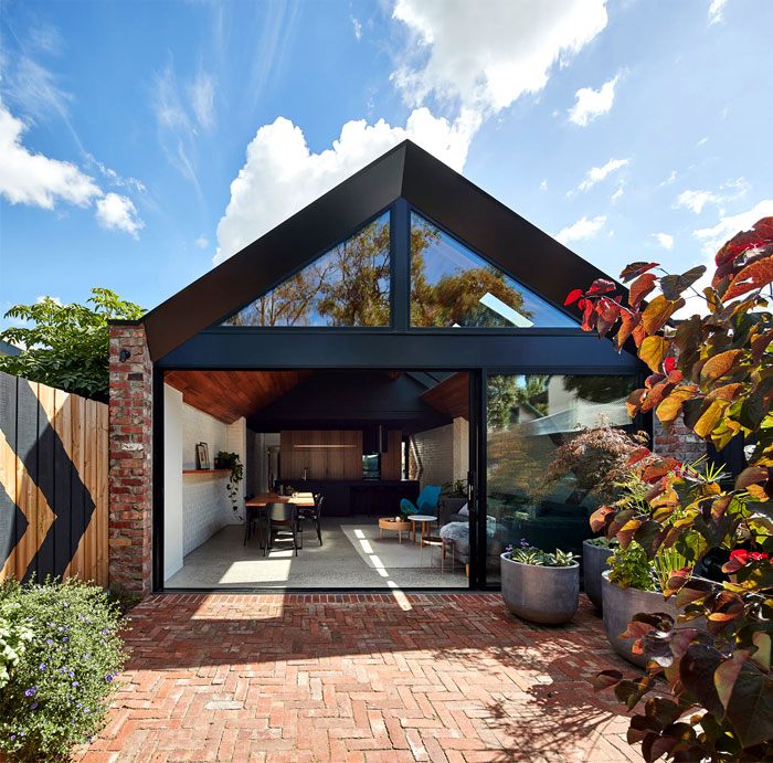 a for architecture transforms cottage two story home 16