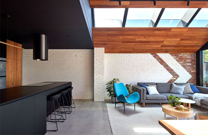 a for architecture transforms cottage two story home 7
