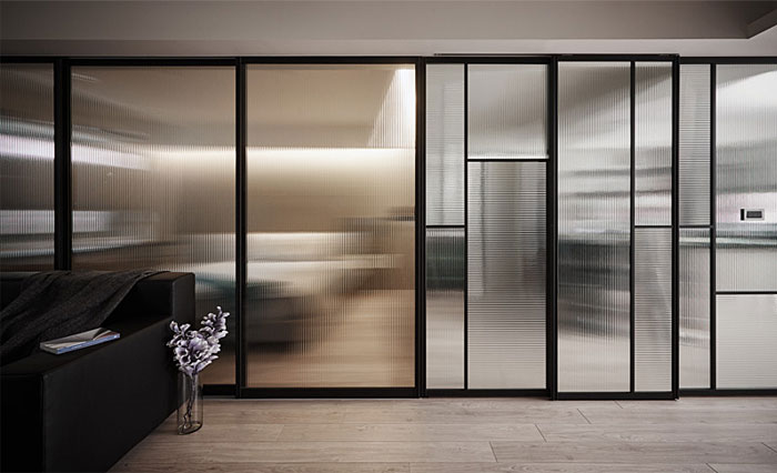 bed behind frosted glass pocket doors