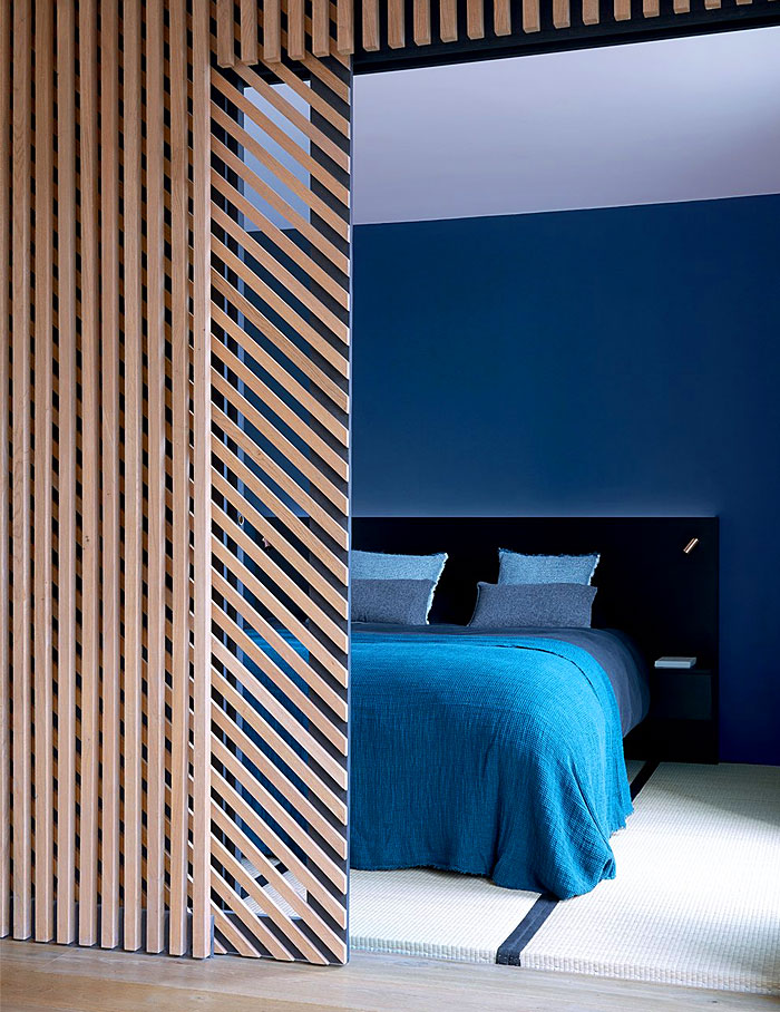 hide the bed behind a decorative partition