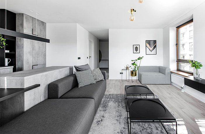 Trendy Brass Black And Gray Decor Gives Glamor To Apartment