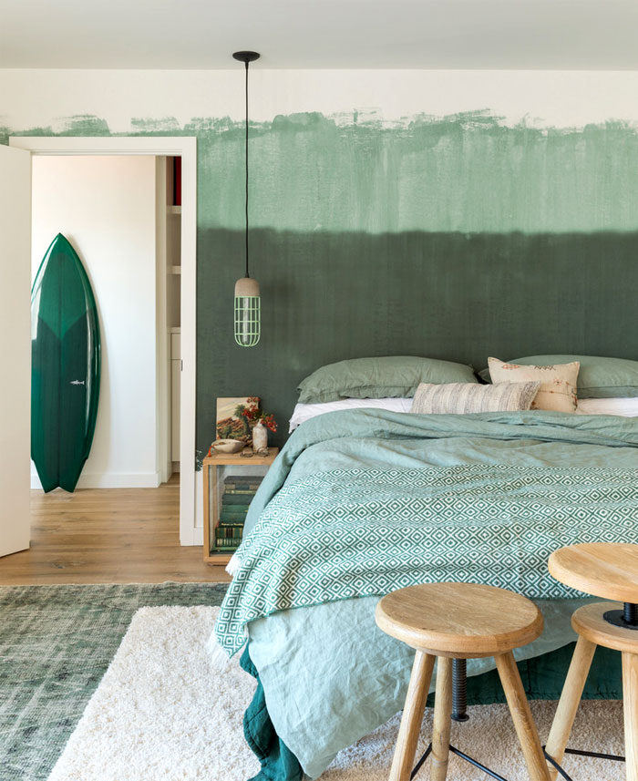 green wall decor bachelor bedroom