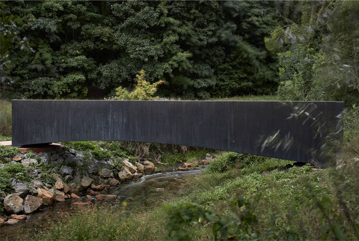 bridge made concrete aoc architects 8