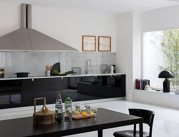 black gloss kitchen gray marble backsplash