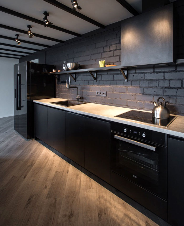 black kitchen black bricks art gallery lighting