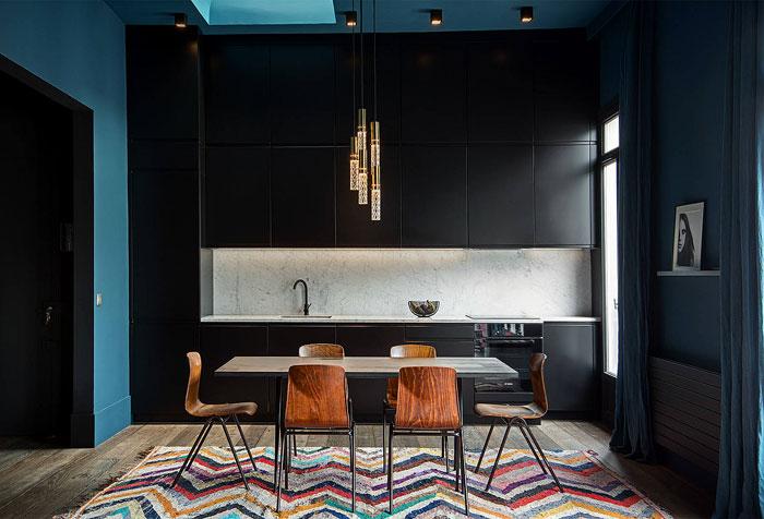 black kitchen blue walls