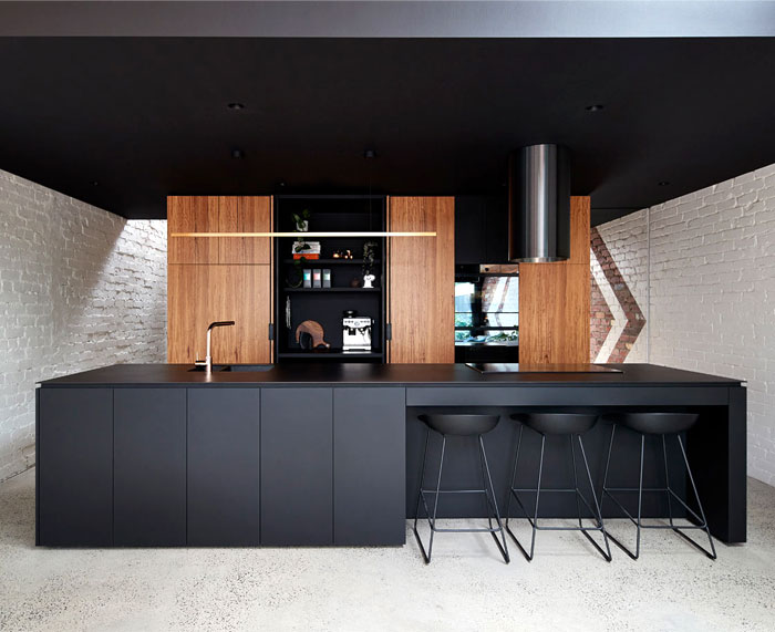black kitchen cabinets with natural wood accents