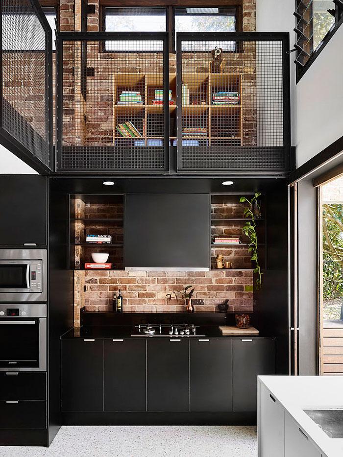 black kitchen exposed brick wall