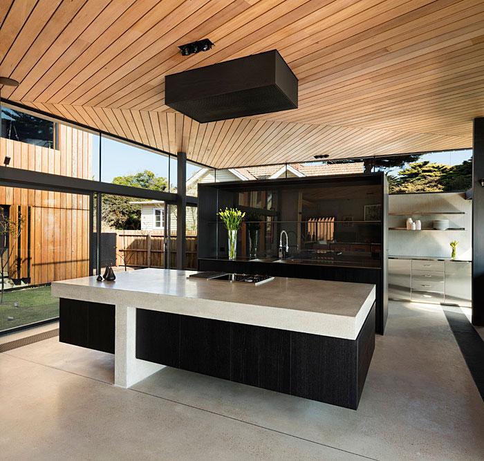 black kitchen natural wood ceiling