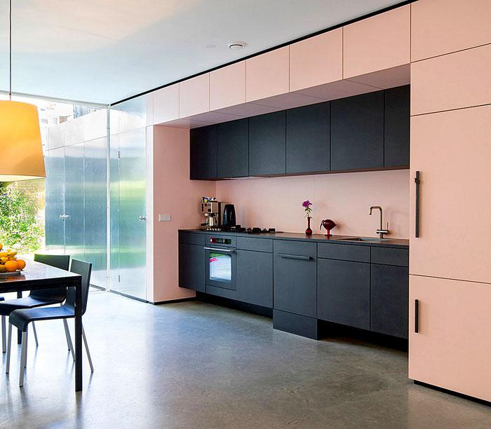 black kitchen pink walls