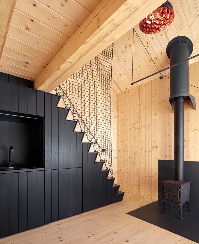black kitchen under the stairs wood cabin
