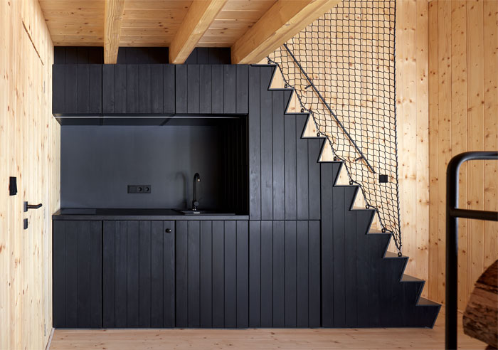 black kitchen under the stairs