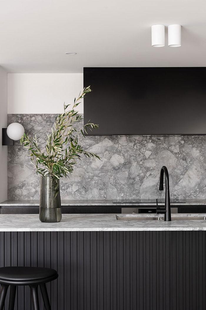 gray marble backsplash black kitchen cabinets