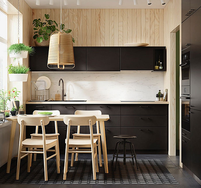 light filled space black kitchen and wood