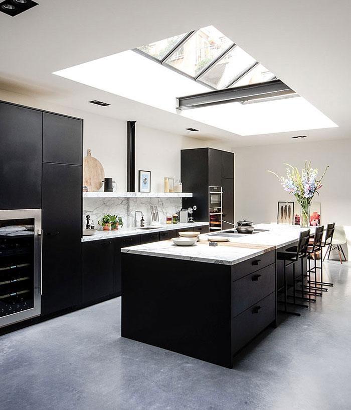 light filled space black kitchen